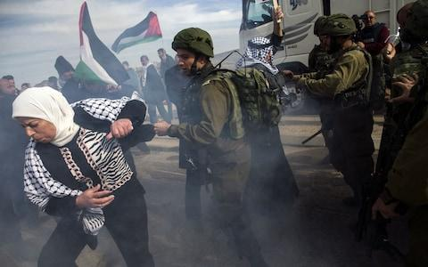 Palestinian demonstrators scuffle with Israeli soldiers during a demonstration at the Huwara checkpoint, south of Nablus in the Israeli-occupied West Bank - Credit: AFP