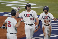 United States' Triston Casas (26) celebrate with Todd Frazier, left, and Eddy Alvarez right afterhitting a two run home run during the fourth inning of a baseball game against South Korea at the 2020 Summer Olympics, Saturday, July 31, 2021, in Yokohama, Japan. (AP Photo/Sue Ogrocki)