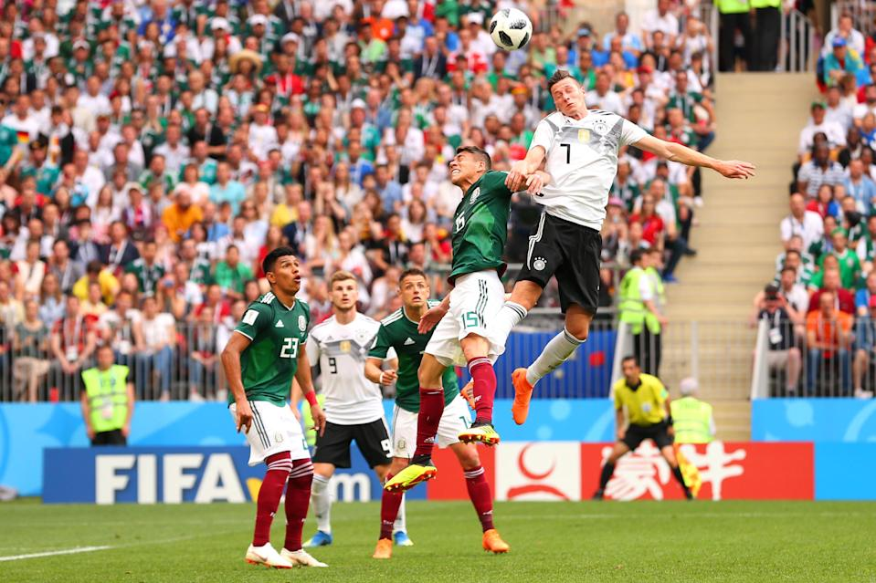 <p>Julian Draxler of Germany competes with Hector Moreno of Mexico during the 2018 FIFA World Cup Russia group F match between Germany and Mexico at Luzhniki Stadium on June 17, 2018 in Moscow, Russia. (Photo by Robbie Jay Barratt – AMA/Getty Images) </p>