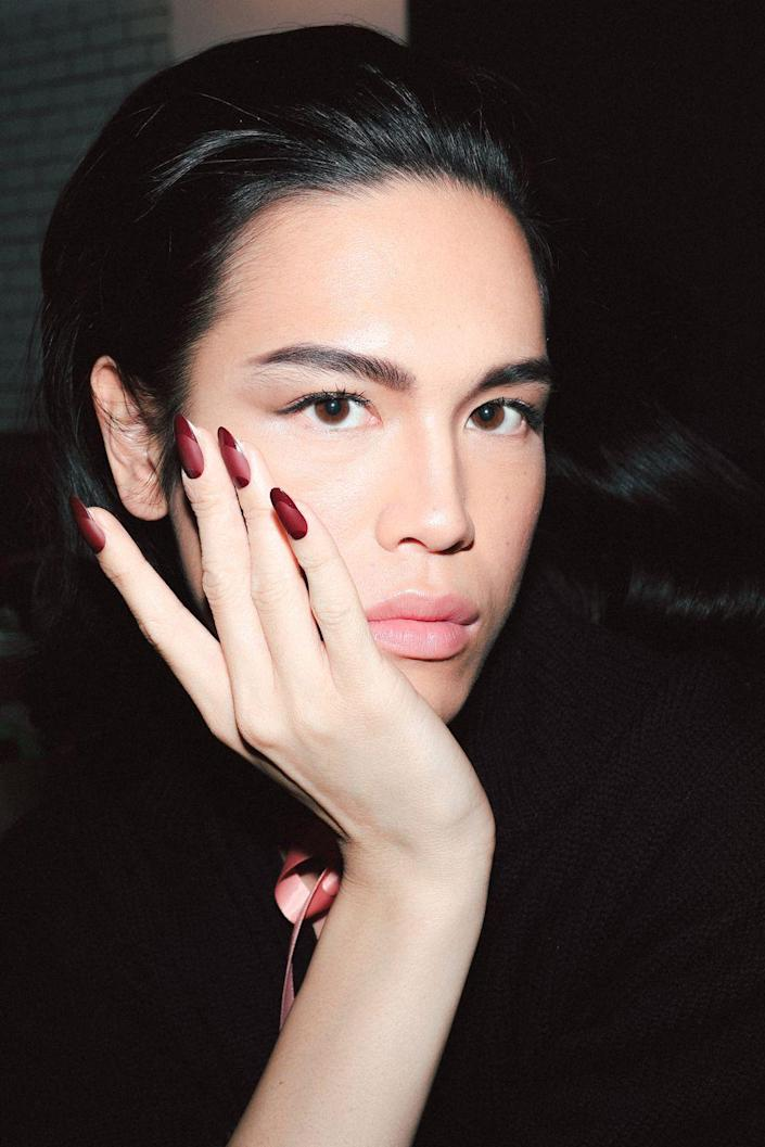 "<p>Prabal Gurung turned to New York City to inspire his latest collection. Resilience, grit, and self-expression are the foundation of the collection, which translated to a strong yet simple beauty look with bold accents. The nails—custom press-ons by <a href=""https://www.kissusa.com/nails"" rel=""nofollow noopener"" target=""_blank"" data-ylk=""slk:KISS"" class=""link rapid-noclick-resp"">KISS</a>—combined matte and glossy textures in a striking Bordeaux shade. </p>"