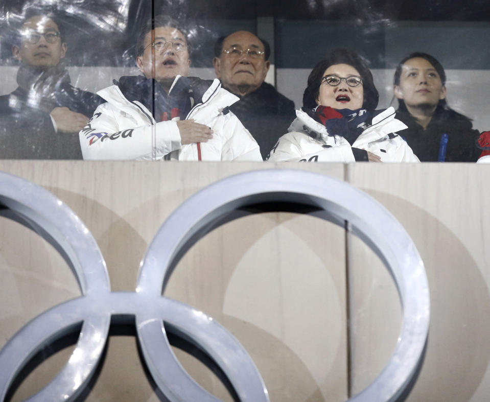 """FILE - In this Feb. 9, 2018, file photo, Kim Yo Jong, right, North Korean leader Kim Jong Un's sister, and Kim Yong Nam, president of the Presidium of the Presidium of the Supreme People's Assembly of North Korea, center, observe with South Korean President Moon Jae-in, second from left, and first lady Kim Jung-sook during the opening ceremony of the 2018 Winter Olympics in Pyeongchang, South Korea, Friday, Feb. 9, 2018. North Korea has decided not to participate in this year's Olympic Games in Tokyo as it continues a self-imposed lockdown amid the coronavirus pandemic. A website run by the North's Sports Ministry said the decision was made during a national Olympic Committee meeting on March 25, 2021 where members prioritized protecting athletes from the """"world public health crisis caused by COVID-19."""" (AP Photo/Jae C. Hong, File)"""