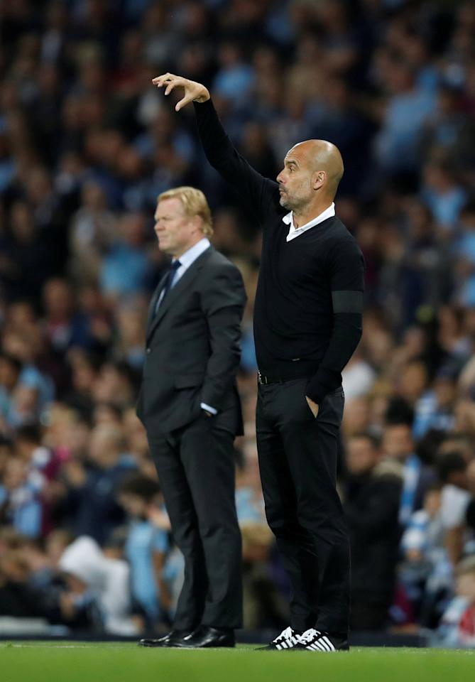 "Football Soccer - Premier League - Manchester City vs Everton - Manchester, Britain - August 21, 2017   Manchester City manager Pep Guardiola and Everton manager Ronald Koeman    Action Images via Reuters/Carl Recine    EDITORIAL USE ONLY. No use with unauthorized audio, video, data, fixture lists, club/league logos or ""live"" services. Online in-match use limited to 45 images, no video emulation. No use in betting, games or single club/league/player publications. Please contact your account representative for further details.     TPX IMAGES OF THE DAY"