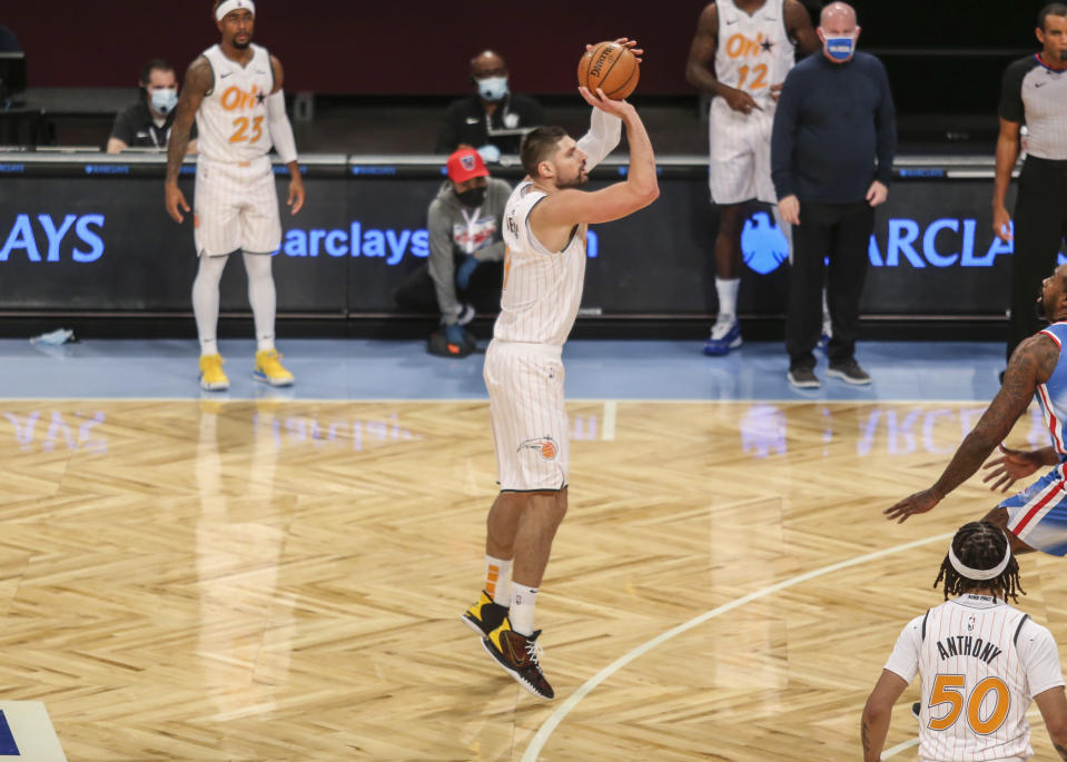 Jan 16, 2021; Brooklyn, New York, USA; Orlando Magic center Nikola Vucevic (9) takes a three point shot in the third quarter against the Brooklyn Nets at Barclays Center. Mandatory Credit: