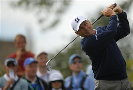 Fred Couples of the U.S. watches his tee shot on the second hole during the first round of the British Open golf Championship at Muirfield in Scotland
