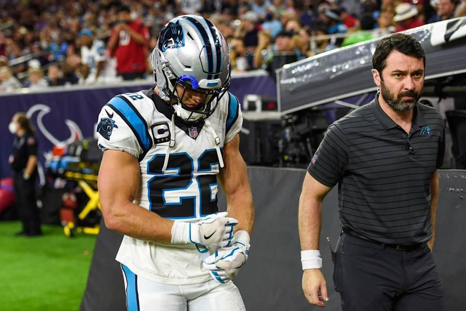 Panthers running back Christian McCaffrey, left, walks to the locker room with team athletic trainer Jean-Baptise Laporte after a hamstring injury during the game against the Texans at NRG Stadium on Thursday, September 21, 2021 in Houston, TX.