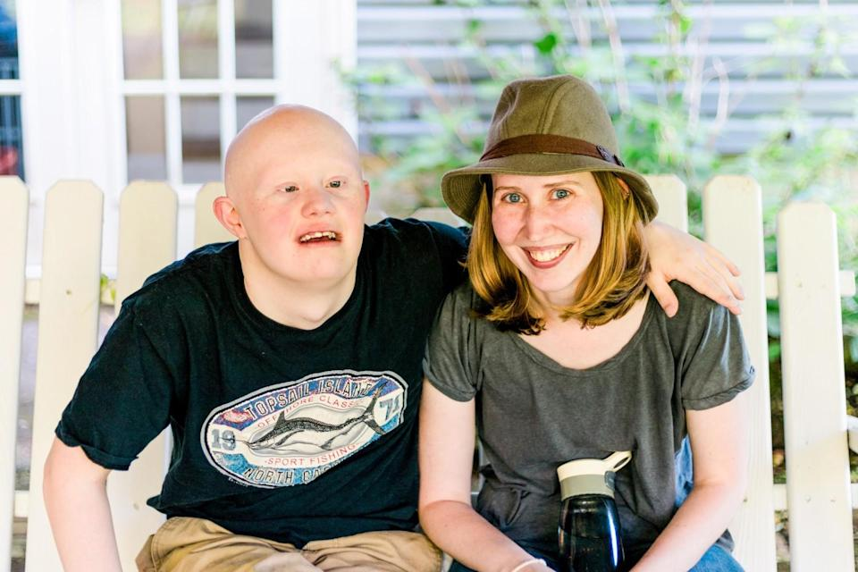 Anna Moyer, founder of Accessible Chef, sitting with her brother Sam.
