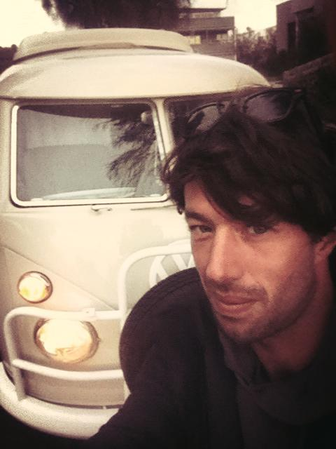 Sean McKinnon, shot dead in New Zealand, poses for a photo in front of a kombi van in 2016.