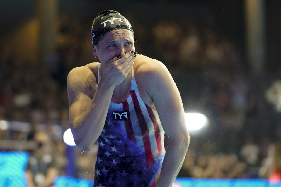 Annie Lazor reacts after winning the women's 200 breaststroke during wave 2 of the U.S. Olympic Swim Trials on Friday, June 18, 2021, in Omaha, Neb. (AP Photo/Jeff Roberson)