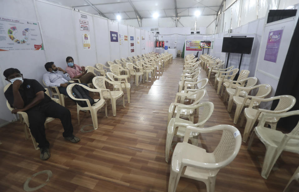Health workers sit in the waiting area of vaccination center which has been closed because of shortage of the COVID-19 vaccine in Mumbai, India, Tuesday, April 20, 2021. India has decided to vaccinate everyone above 18 from May 1 as the government battles record high surge in coronavirus cases in the country. (AP Photo/Rafiq Maqbool)