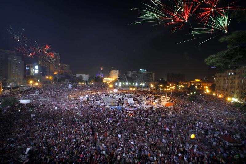 Fireworks light the sky as opponents of Egypt's Islamist President Mohammed Morsi celebrate in Tahrir Square in Cairo, Egypt, Wednesday, July 3, 2013. Army troops backed by armor and including commandos have deployed across much of the Egyptian capital, near protest sites and at key facilities and major intersections. The deployment is part of a bid by the military to tighten its control of key institutions Wednesday, slapping a travel ban on embattled president Mohammed Morsi and top allies in preparation for an almost certain push to remove the Islamist president with the expiration of an afternoon deadline. (AP Photo/Amr Nabil)