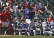 Feb 28, 2019; Tempe, AZ, USA; Texas Rangers first baseman Ronald Guzman (11) hits a home run in the first inning during a spring training game against the Los Angeles Angels at Tempe Diablo Stadium. Mandatory Credit: Rick Scuteri-USA TODAY Sports
