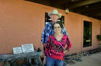 Cattle ranchers Jim and Sue Chilton are seen at home on their 50,000 acre ranch in Arivaca, Arizona on October 14, 2016 a few hours drive from where a barbed-wire fence is all that separates the United States and Mexico