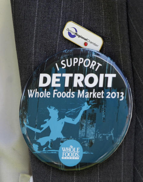 A supporter of Whole Foods Market wears a button during a ground breaking ceremony for the retailer in Detroit, Monday, May 14, 2012. The Austin, Texas-based retailer plans to open a 20,000-square-foot supermarket with about 75 employees next year. The company began looking at Midtown in 2010. Midtown is one of the few areas in the city that is seeing population growth. (AP Photo/Carlos Osorio)