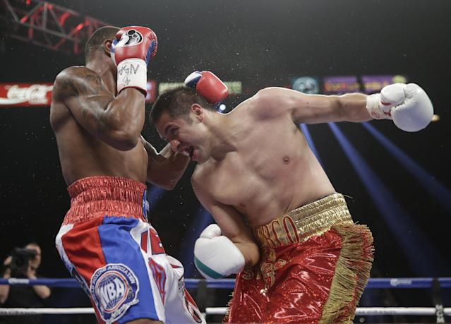 Marco Periban, right, from Mexico, and J'Leon Love, from Las Vegas, exchange blows in their WBA super middleweight title boxing fight Saturday, May 3, 2014, in Las Vegas. (AP Photo/Eric Jamison)