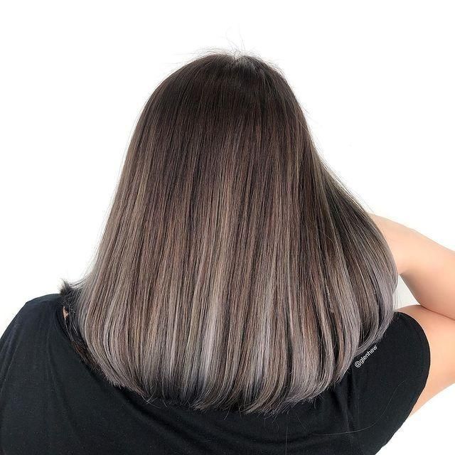 """<p>The silver ends on this ash-brown hair color makes it a <strong>super-pretty option for long bobs or <a href=""""https://www.cosmopolitan.com/style-beauty/beauty/g31438538/asymmetrical-haircut-ideas/"""" rel=""""nofollow noopener"""" target=""""_blank"""" data-ylk=""""slk:asymmetrical cuts"""" class=""""link rapid-noclick-resp"""">asymmetrical cuts</a></strong>. Just run a <a href=""""https://www.cosmopolitan.com/style-beauty/beauty/g12837010/best-hair-straightener-flat-iron/"""" rel=""""nofollow noopener"""" target=""""_blank"""" data-ylk=""""slk:flat iron"""" class=""""link rapid-noclick-resp"""">flat iron</a> through your ends to recreate this sleek-AF texture.</p><p><a href=""""https://www.instagram.com/p/B8Q6ElkJlL1/"""" rel=""""nofollow noopener"""" target=""""_blank"""" data-ylk=""""slk:See the original post on Instagram"""" class=""""link rapid-noclick-resp"""">See the original post on Instagram</a></p>"""