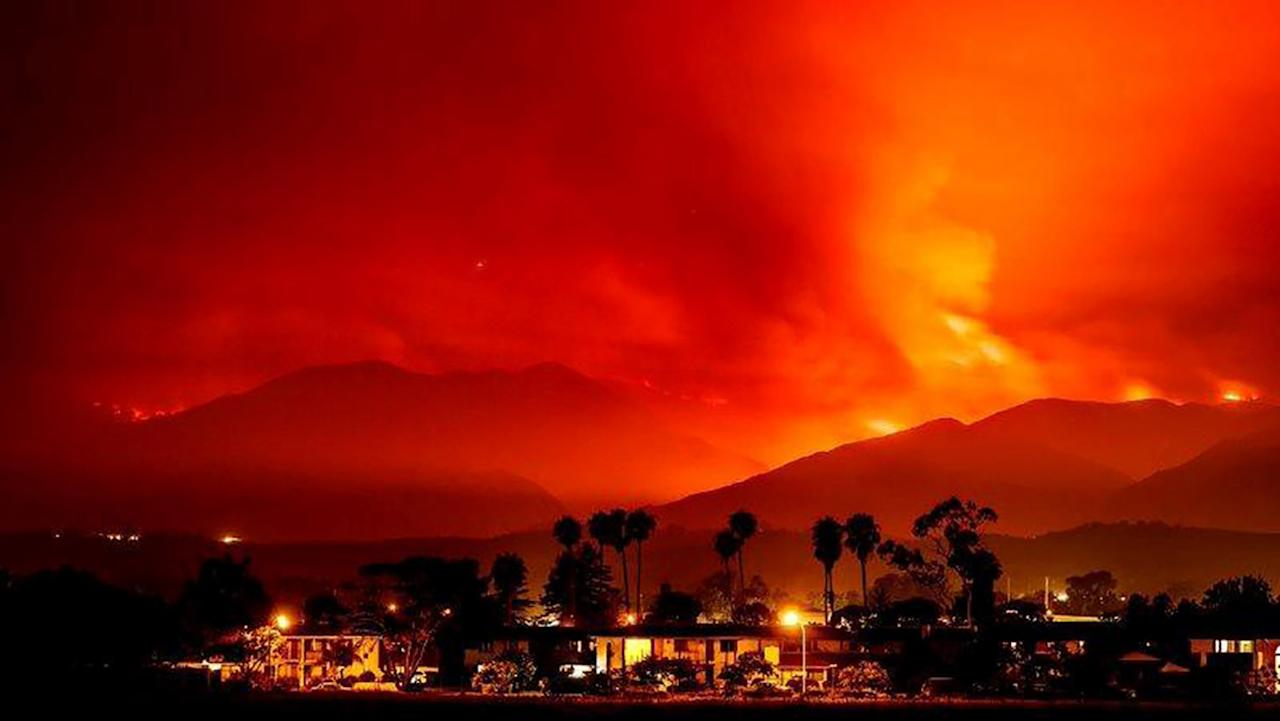 <p>Smoke is illuminated by the Whittier wildfire near Santa Ynez, California, U.S. July 8, 2017. (Michael Nekrasov/Handout via Reuters) </p>