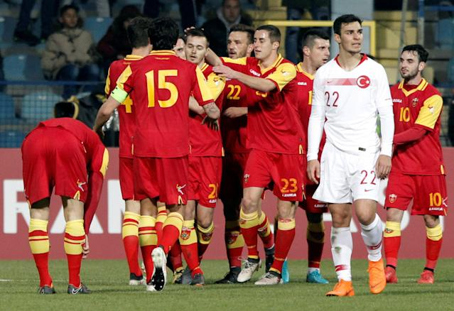 Soccer Football - International Friendly - Montenegro vs Turkey - Podgorica City Stadium, Podgorica, Montenegro - March 27, 2018 Montenegro's Mirko Ivanic celebrates scoring their first goal with team mates REUTERS/Stevo Vasiljevic