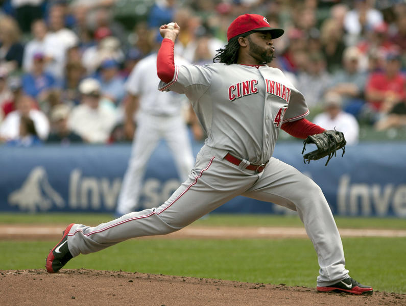 Cincinnati Reds starter Johnny Cueto pitches to the Chicago Cubs during the first inning of a baseball game in Chicago on Thursday, Sept. 20, 2012. (AP Photo/Charles Cherney)