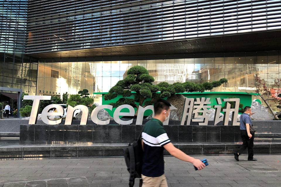 People walk past a Tencent sign at the company headquarters in Shenzhen, Guangdong province, China, on August 7, 2020. Photo: Reuters