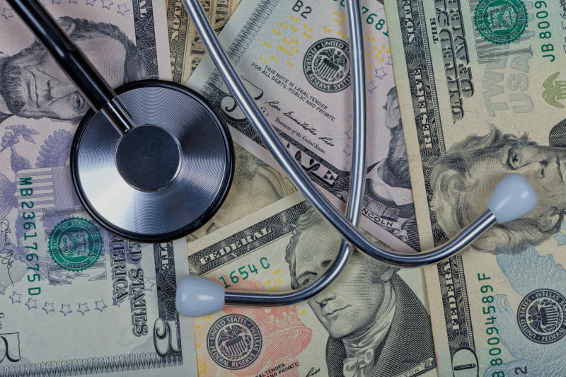 A stethoscope on top of American dollar bills. Photo: Getty