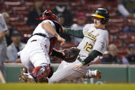 Oakland Athletics' Sean Murphy (12) slides out at home as he is tagged out by Boston Red Sox's Christian Vazquez, left, in the seventh inning of a baseball game, Thursday, May 13, 2021, in Boston. (AP Photo/Steven Senne)