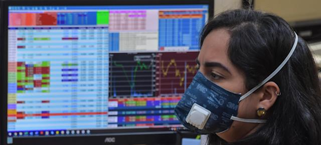 Traders work at a brokerage company. (Nelson Almeida/AFP via Getty Images)
