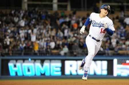 May 25, 2018; Los Angeles, CA, USA; Los Angeles Dodgers center fielder Enrique Hernandez (14) rounds the bases after hitting a solo home run in the third inning against the San Diego Padres at Dodger Stadium. Mandatory Credit: Gary A. Vasquez-USA TODAY Sports