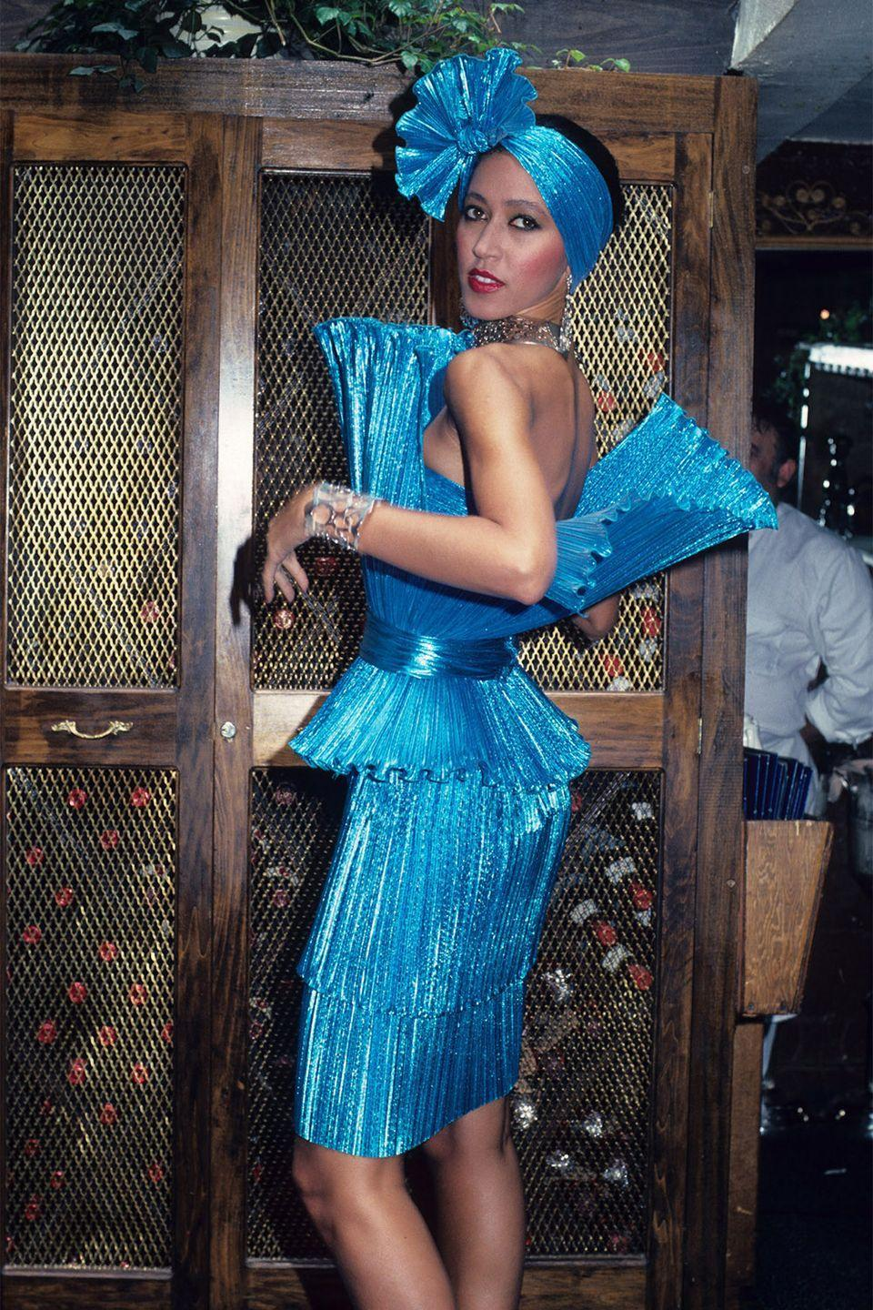 <p>Pat Cleveland in a metallic blue party dress at Marc Bouwer's runway show during New York Fashion Week. </p>