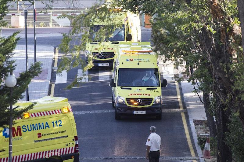 Ambulances carrying Roman Catholic priest Miguel Pajares, who contracted the deadly Ebola virus, and Spanish nun Juliana Bonoha Bohe arrive at the Carlos III hospital in Madrid on August 7, 2014