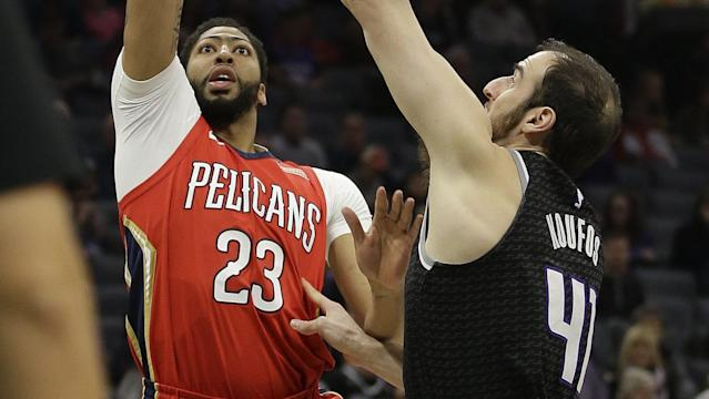 Anthony Davis did not return after turning his ankle on Wednesday night. (AP)