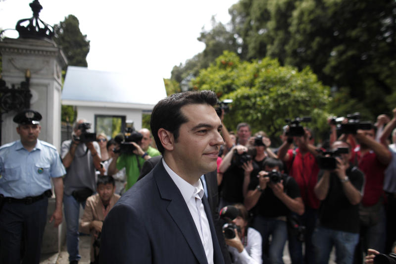 Alexis Tsipras, head of the Radical Left Coalition (SYRIZA) exits the Presidential Palace after his meeting with Greek President Karolos Papoulias, to formally take the mandate to form a coalition government in Athens, Tuesday, May 8, 2012. Greece's commitment to austerity is no longer valid because voters have rejected those deals, a left-wing party leader declared Tuesday as he tried to form a new coalition government. (AP Photo/Kostas Tsironis)