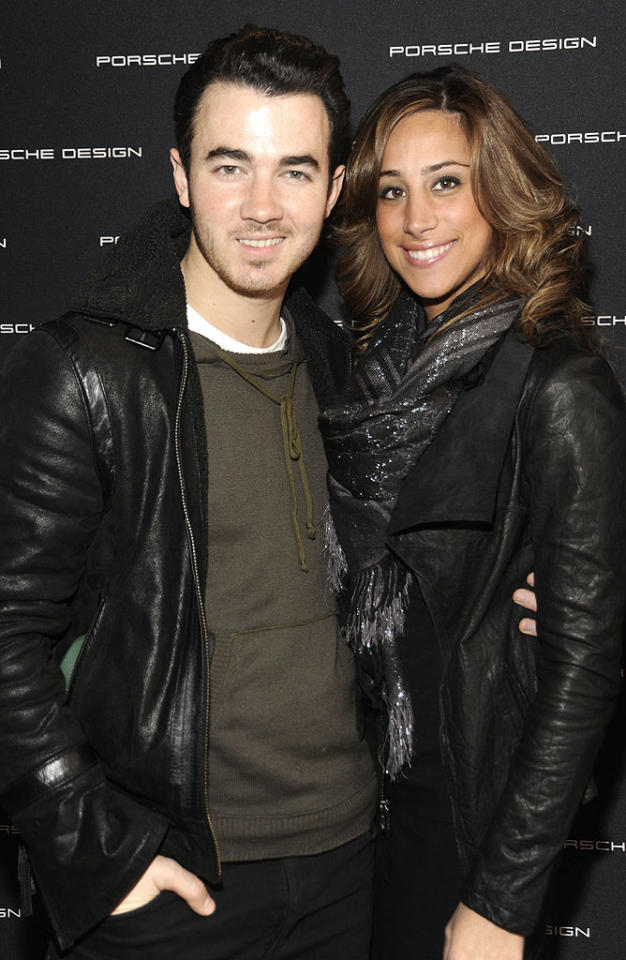 """As one-third of the enormously popular singing group, The Jonas Brothers, Kevin Jonas could have had anyone -- but his heart belongs to New Jersey-based hairdresser Danielle Deleasa. The two met in 2007 while both were on vacation in the Bahamas, and two years later they married in a fairytale wedding at a castle on Long Island, New York. Jonas has largely stayed out of the limelight as his band is on hiatus and he and Deleasa enjoy married life. Is a Jonas baby on the horizon? """"Not right now for us, but it will happen in the future,"""" he told <i>People</i> last year. (2/15/2012)"""