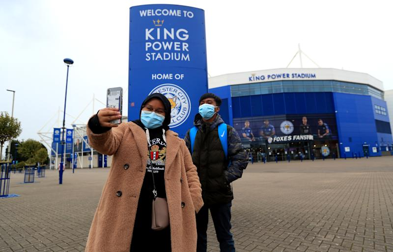 Two people taking a selfie outside the King Power Stadium, home of Leicester City. Premier League clubs will gather via conference call on Thursday morning to discuss fixtures and finances amid the coronavirus pandemic. Top-flight action is suspended until April 4 at the earliest, and measures around social distancing mean no clubs will be present in person for the meeting. (Photo by Mike Egerton/PA Images via Getty Images)