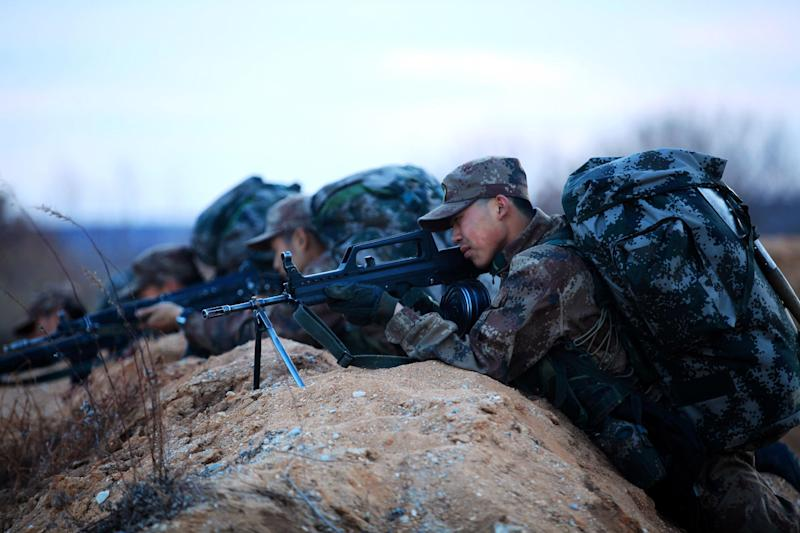 This picture taken on April 9, 2014 shows soldiers taking part in an exercise in Heihe, in northeast China's Heilongjiang province