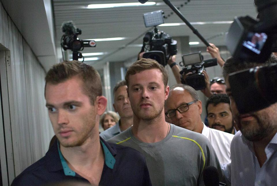 U.S. Olympic swimmers Gunnar Bentz (left) and Jack Conger leave a Rio police station early Thursday. (AP)