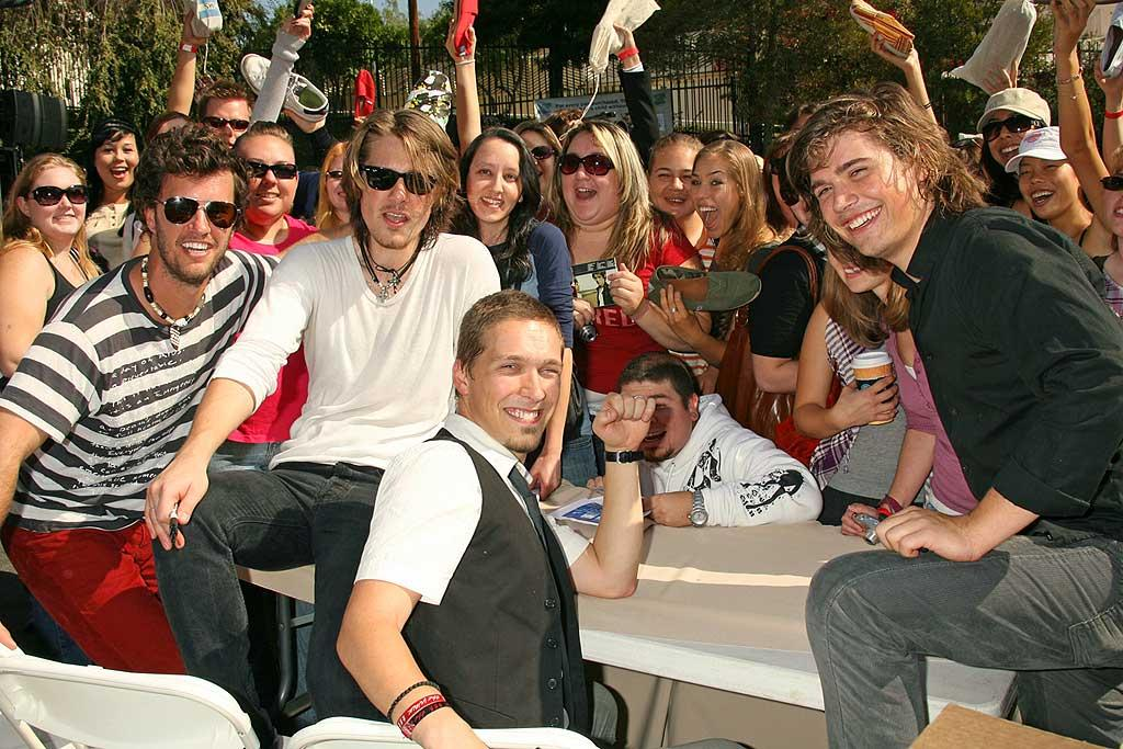 """Fans join Isaac, Taylor, and Zac Hanson on a walk through West Hollywood to help fight poverty and HIV/AIDS in Africa. Russ Einhorn/<a href=""""http://www.splashnewsonline.com"""" target=""""new"""">Splash News</a> - October 30, 2007"""