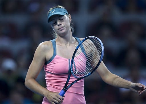 Russia's Maria Sharapova reacts after losing a point to Victoria Azarenka of Belarus during their women's final match at the China Open tennis tournament in Beijing Sunday, Oct. 7, 2012. Azarenka defeated Sharapova 6-3, 6-1. (AP Photo/Andy Wong)