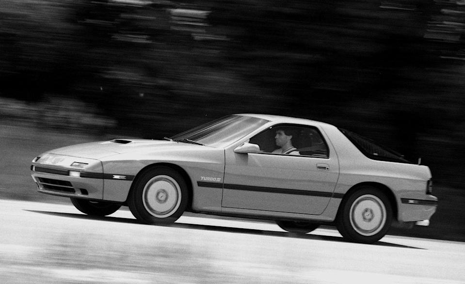 <p>Where the spindly, first-generation RX-7 was rudimentary, the Turbo was serious: a complex rear suspension with passive steering, a twin-scroll turbo with an asymmetrical hood scoop feeding an air-to-air intercooler, round yet angular European styling, and 182 horses made the Mazda both a convincing grand tourer and a highly capable sports car. Looking back, we can recognize the second-gen RX-7 as the logical stepping-stone that led to the world-beating twin-turbo monster that Mazda brought out in 1992. But on its own, the high-tech, scintillating, and stylish RX-7 Turbo of the late '80s embodied the best attributes of the era's Japanese sports cars. <em>—Robert Sorokanich</em><br></p>