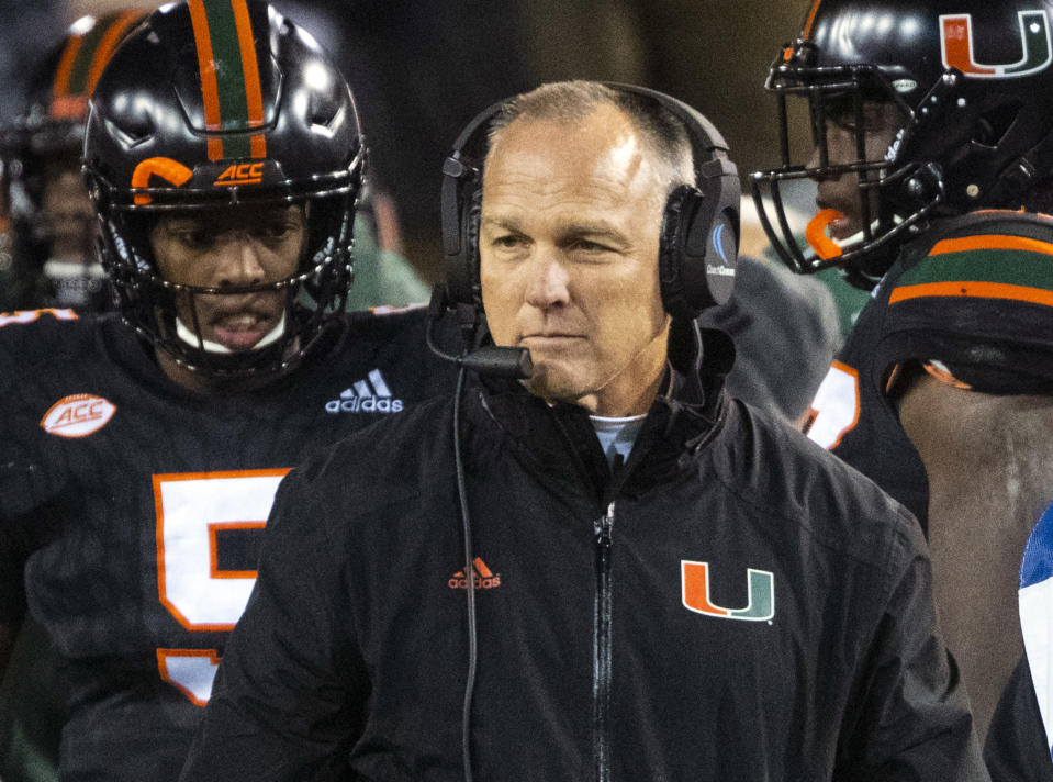FILE - In this Nov. 10, 2018, file photo, Miami coach Mark Richt walks the sideline during the second half of an NCAA college football game against Georgia Tech in Atlanta. Former Georgia and Miami football coach Richt has been diagnosed with Parkinson's disease. Richt, who guided the Bulldogs for 15 seasons and closed out his coaching career at alma mater Miami, made the announcement Thursday, July 1, 2021, on Twitter. (AP Photo/John Amis, File)