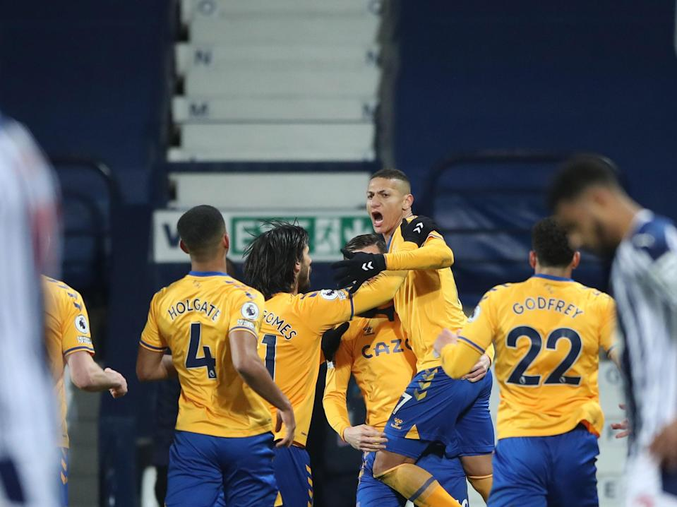 Richarlison celebrates with his team-mates after scoring the winner (POOL/AFP via Getty Images)