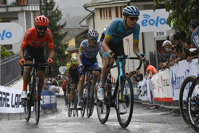 Russian road race champion Aleksandr Vlasov (Astana) climbs up through the wet streets of Barolo on his way to fourth place at the 2020 Gran Piemonte