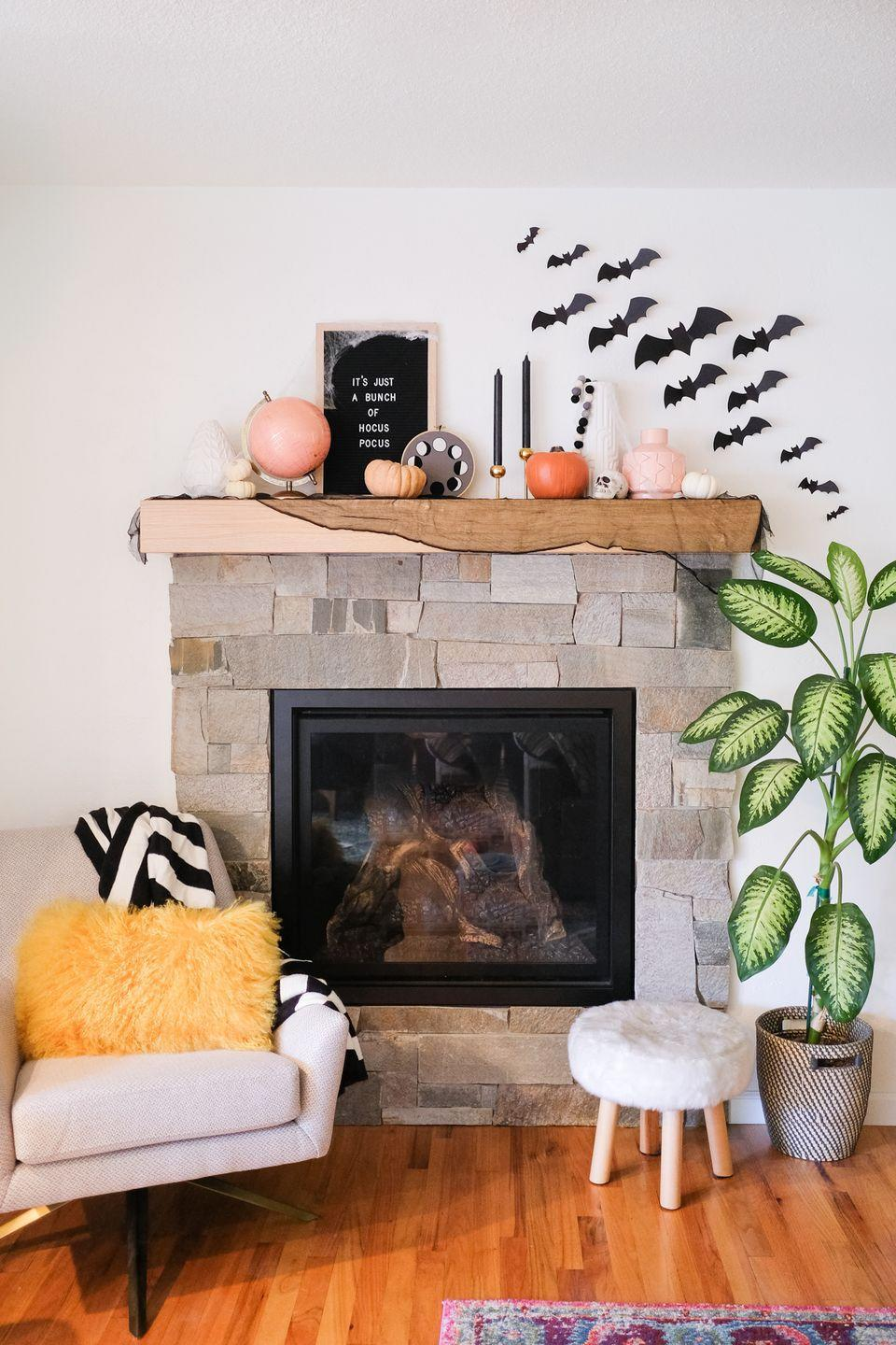 """<p>You don't need to invest much in new Halloween decor in order to create a festive, spooky look. Just dig into items you already have on hand — like candlesticks, fabric, bowls and books in a Halloween color palette — and <em>zhush</em> up the look with dollar store cobwebs and these multipurpose bat printables.</p><p><em><a href=""""https://lovelyindeed.com/halloween-home-decor-ideas/"""" rel=""""nofollow noopener"""" target=""""_blank"""" data-ylk=""""slk:Get the printable at Lovely Indeed »"""" class=""""link rapid-noclick-resp"""">Get the printable at Lovely Indeed »</a></em></p>"""