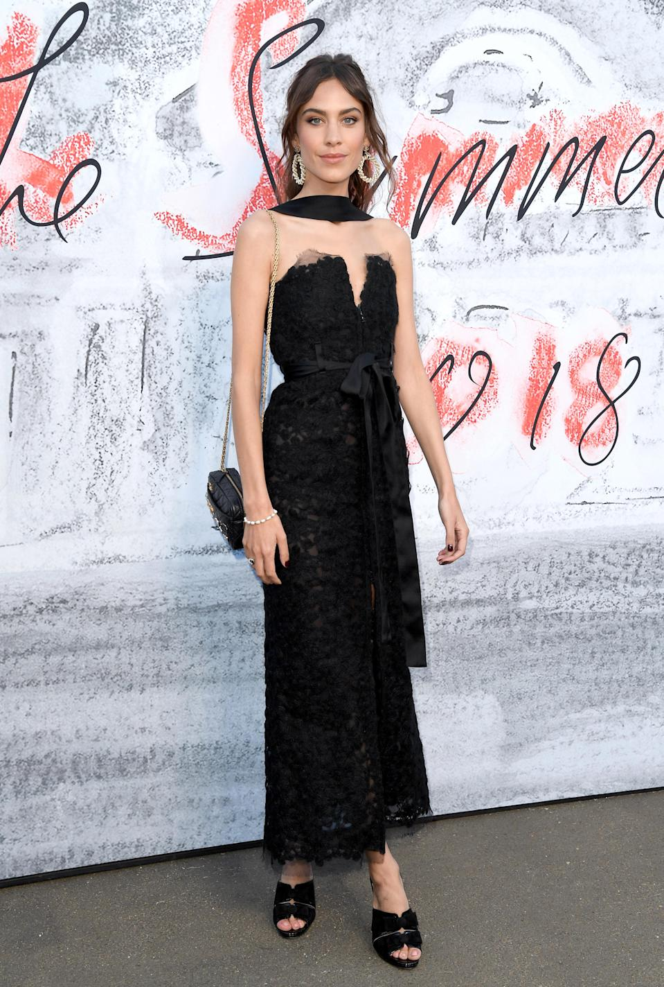 <p>Alexa Chung looked incredible at the Serpentine Summer Party in a cold-shoulder lace gown by Chanel. She accessorised the look with a co-ordinating neck scarf and supersized earrings. [Photo: Getty] </p>