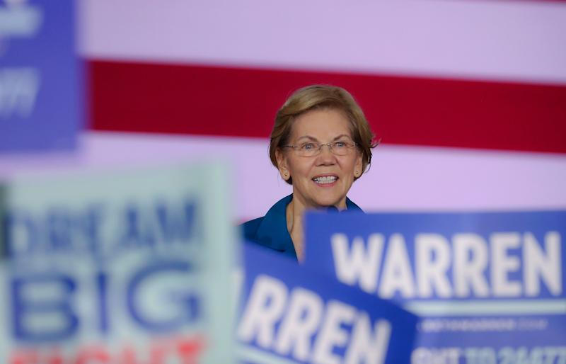Sen. Elizabeth Warren (D-Mass.) would introduce a public option and then, after two years, ask Congress to take up Medicare for All. (Photo: Boston Globe via Getty Images)