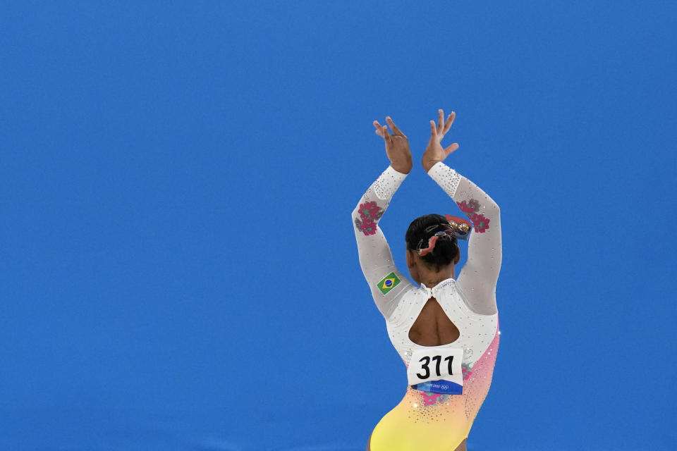 Rebeca Andrade, of Brazil, performs on the floor during the artistic gymnastics women's apparatus final at the 2020 Summer Olympics, Monday, Aug. 2, 2021, in Tokyo, Japan. (AP Photo/Gregory Bull)