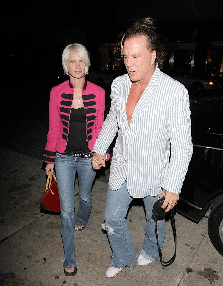 "Ladies, stop drooling. Yes, that is Mickey Rourke. Yes, he is revealing his 55-year-old bare chest under a striped sport coat. Yes, that is, in fact, a ponytail. Yes, his girlfriend is way too attractive to be on his arm. AZ/<a href=""http://www.x17online.com"" target=""new"">X17 Online</a> - May 23, 2008"