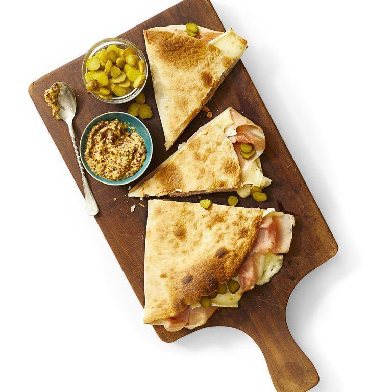 """<p>Put a new spin on your go-to ham and cheese sandwich by stuffing a whole wheat tortilla with the ingredients. Make sure you broil the quesadilla for maximum melting. <br></p><p><em><a href=""""https://www.womansday.com/food-recipes/food-drinks/a31978045/ham-and-brie-quesadilla-recipe/"""" rel=""""nofollow noopener"""" target=""""_blank"""" data-ylk=""""slk:Get the Ham and Brie Quesadilla recipe."""" class=""""link rapid-noclick-resp"""">Get the Ham and Brie Quesadilla recipe.</a></em></p>"""