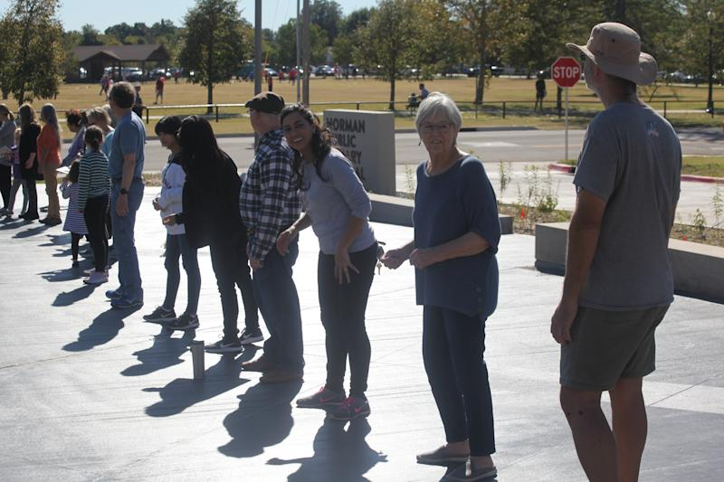 Book lovers in Norman, Oklahoma delivered books to a new library location in a human chain. (Photo: Christian Potts)