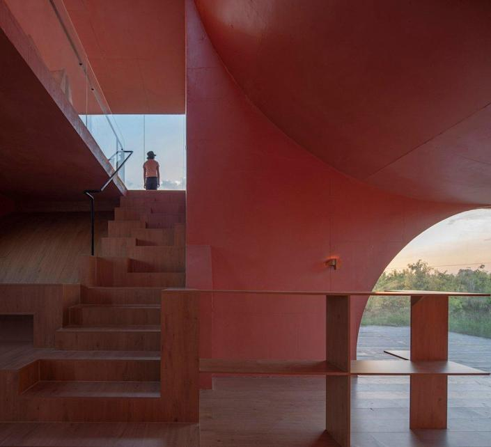 View up the stairs of the Atelier XI-designed