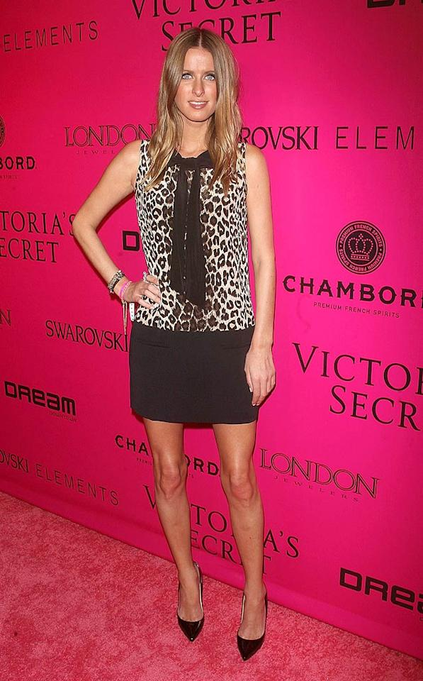 The less famous Hilton sister, Nicky, showed up to the party in a leopard-print top and mini-skirt. (11/9/2011)